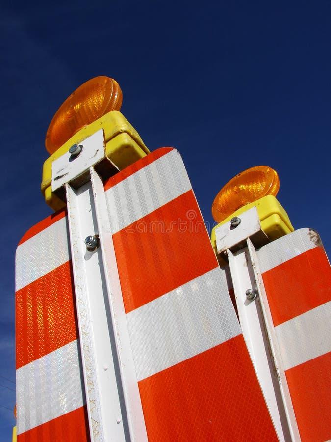 Indicatori luminosi arancioni delle barriere fotografie stock