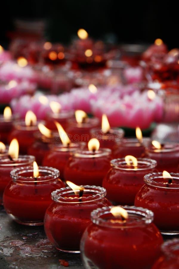 Indicatori luminosi della candela fotografia stock