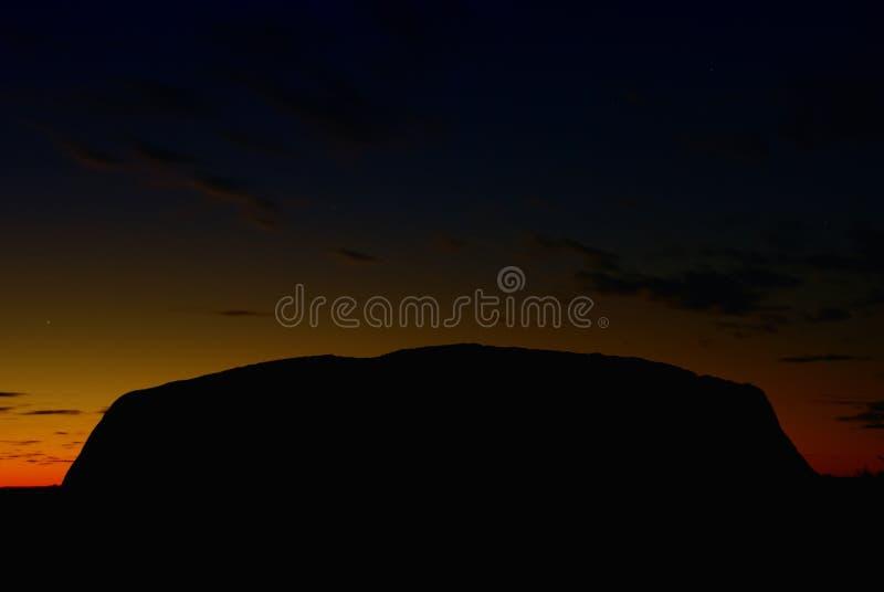 Indicatori luminosi della roccia di Ayers, Australia immagine stock