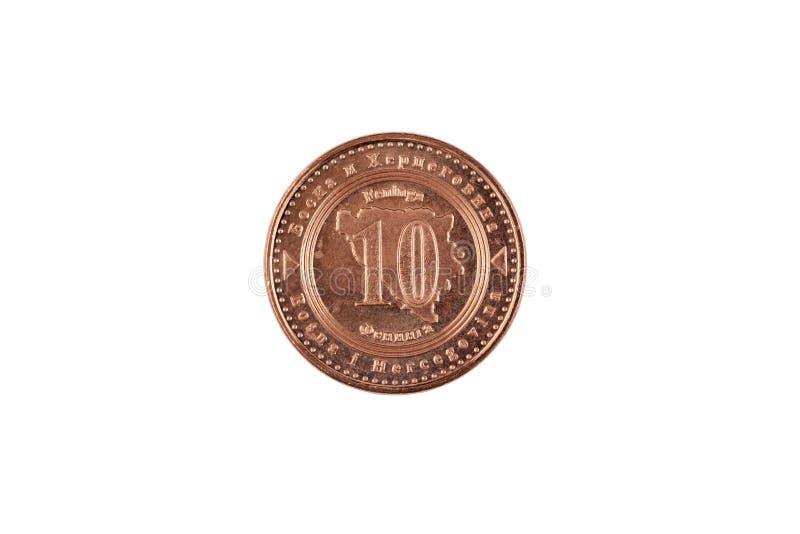Indier tio rupie myntslut upp på vit bakgrund arkivfoton