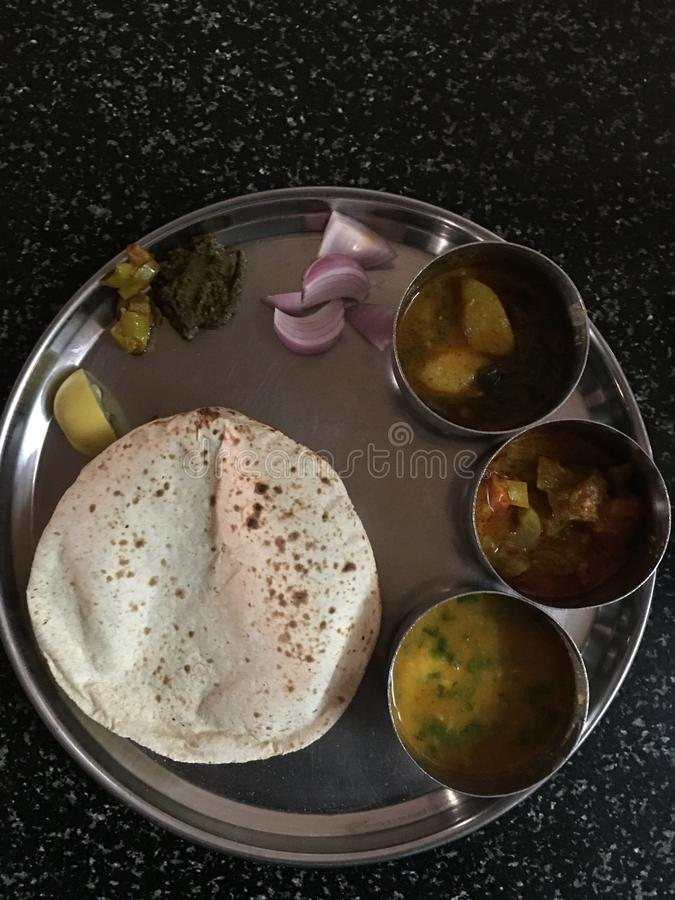 IndierThali mat arkivfoton