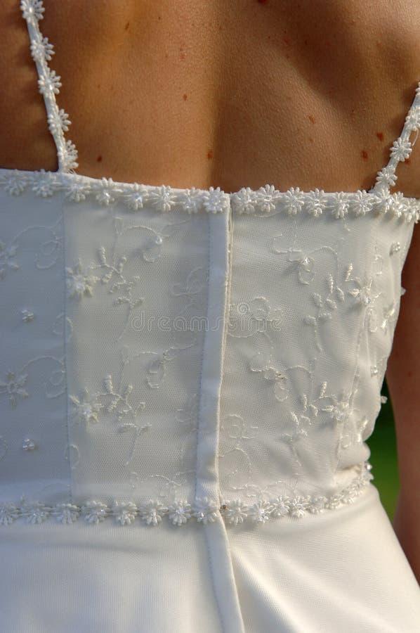 Indietro del vestito da cerimonia nuziale fotografia stock libera da diritti