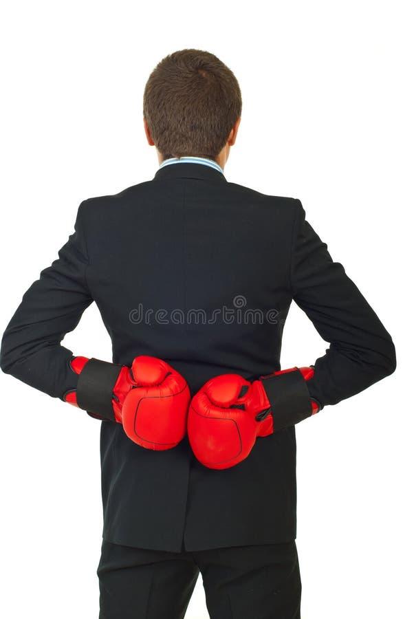Indietro dell'uomo di affari con i guanti di inscatolamento immagine stock