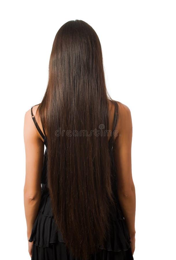 Indietro della femmina sottile con capelli lunghi ha isolato immagine stock