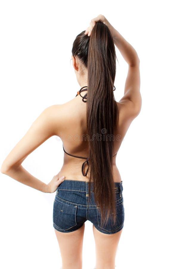 Indietro della femmina sottile con capelli lunghi isolati fotografie stock