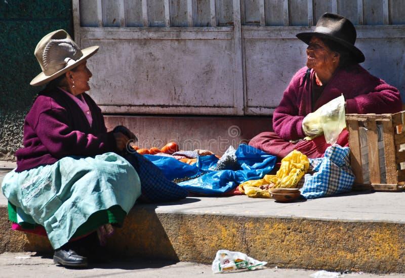 Indigence Ecuadorian women. Indigence Peruvian women sitting on the floor in Ecuador royalty free stock image