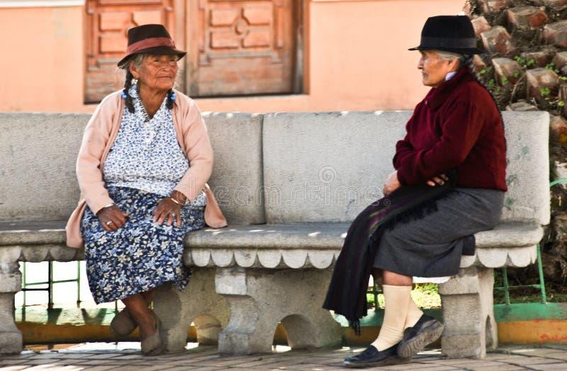 Indigence Ecuadorian women. Indigence Peruvian women sitting on a bench in Ecuador stock photography