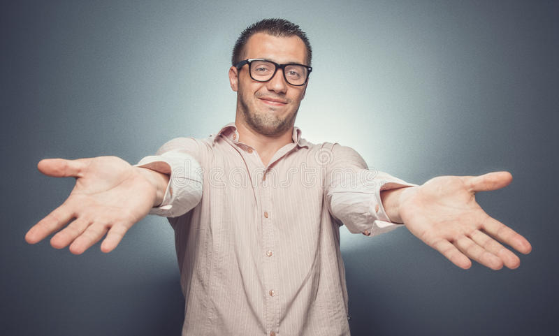 Indigence. Man with outstretched arms. Funny businessman showing empty hands stock photos
