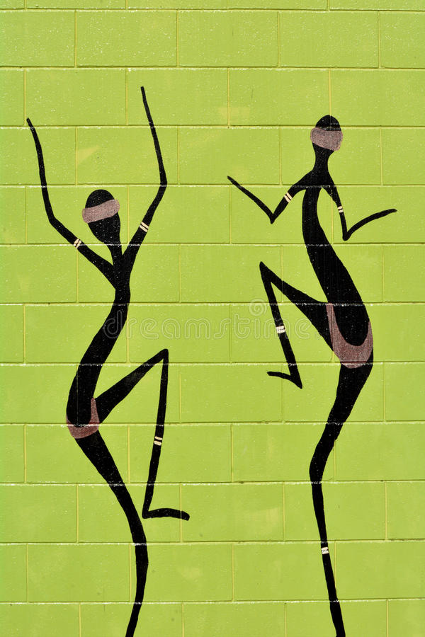 Indigenous Australian art Dot painting of Aboriginal women dancing. It's one of the oldest traditional form of art in the world. Paint marks to tell Aboriginal stock photography