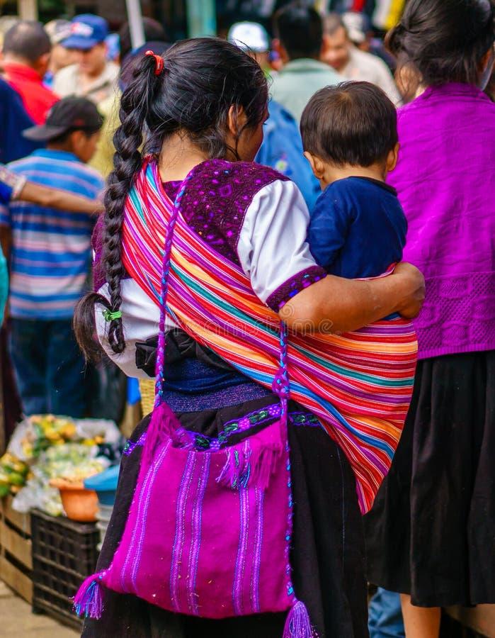 Indigenous maya woman in village of Todos Santos Cuchumatan in Guatemala stock photo