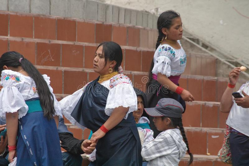 Indigenous people in the park in Cotacachi. Indigenous people on the steps of the church in the park on Day of the Dead in Cotacachi, Ecuador stock photos