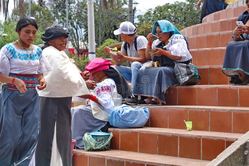 People sitting on steps in Cotacachi. Indigenous people sitting on the steps of the church on Day of the Dead in Cotacachi, Ecuador stock images