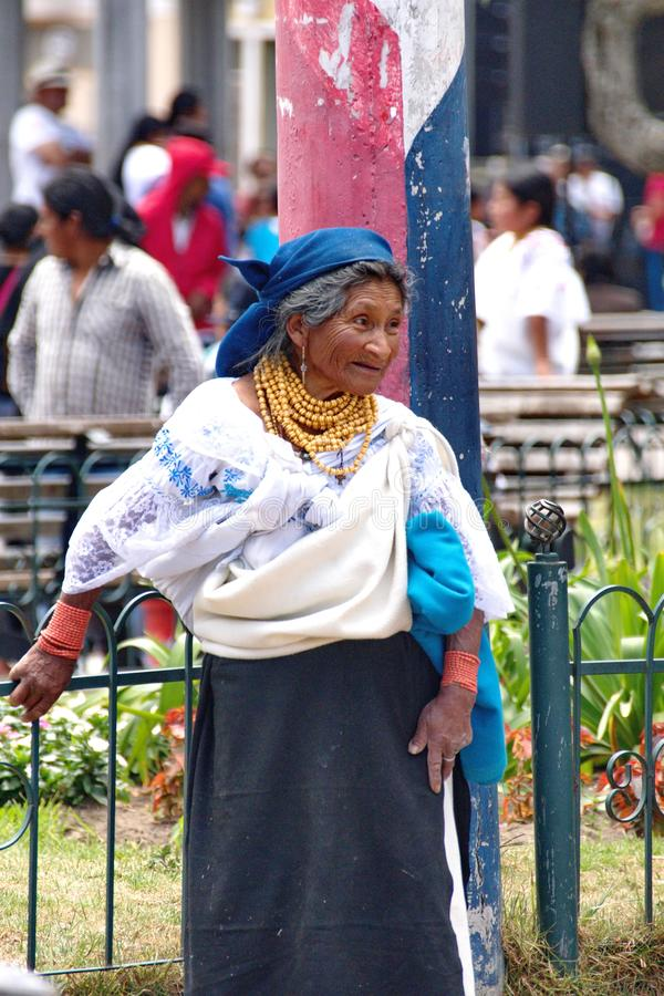 Indigenous woman in Cotacachi. Indigenous woman in the park on Day of the Dead in Cotacachi, Ecuador stock photo