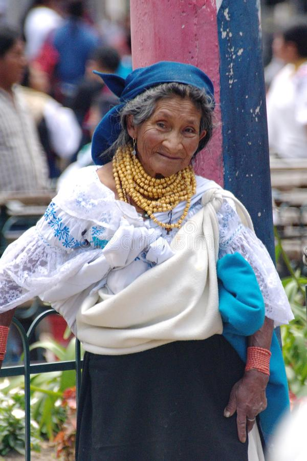 Indigenous woman in Cotacachi. Indigenous woman in the park on Day of the Dead in Cotacachi, Ecuador royalty free stock image