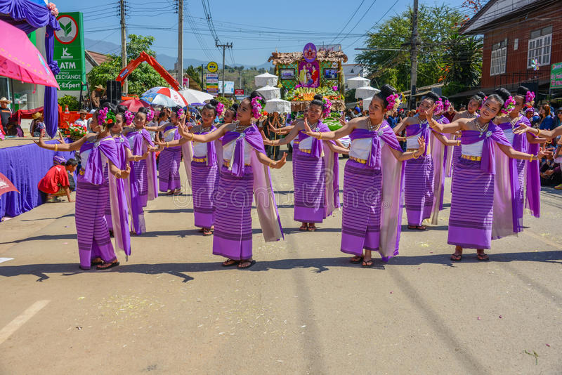 Indigenous women with traditional purple costume dancing in trad stock image