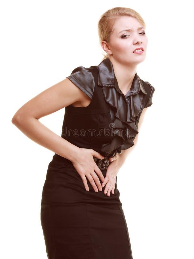 indigestión Mujer que sufre del dolor de estómago aislado fotografía de archivo