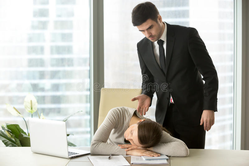 Indignant angry boss caught tired lazy subordinate sleeping at w. Indignant angry boss caught tired lazy employee sleeping at workplace, dissatisfied executive royalty free stock photos
