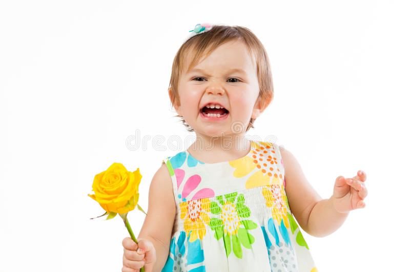 Indignant little girl with a yellow rose, romantic gift royalty free stock photography