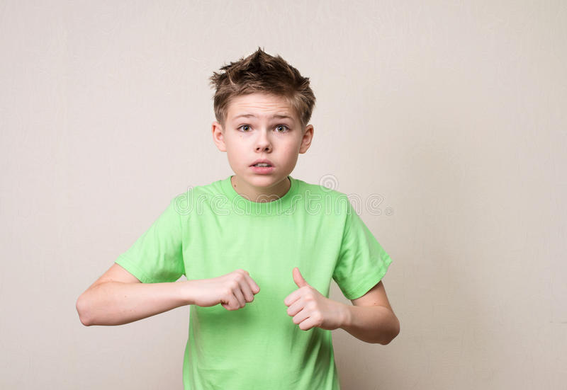 Indignant teen boy rejecting the responsibility denying mistake. With not me or who me? gesture royalty free stock photo