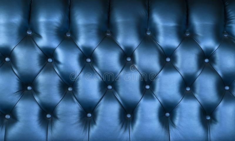 Indigo blue leather capitone background texture stock photography
