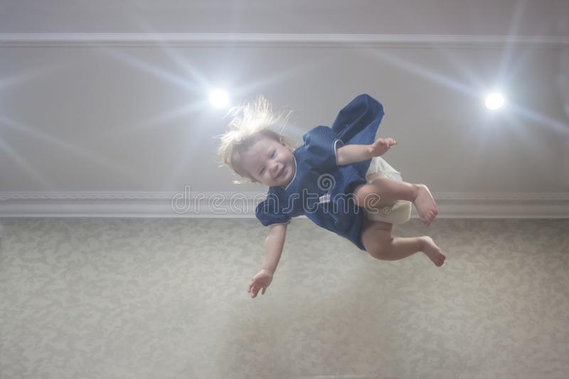Indigo child. girl in blue dress. Super ability to fly stock images