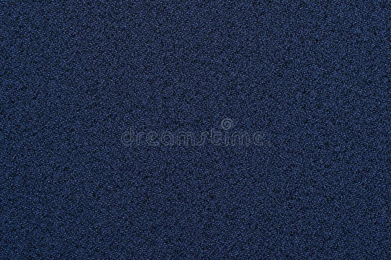 Indigo rough granular fabric texture uniform over the entire surface. royalty free stock images