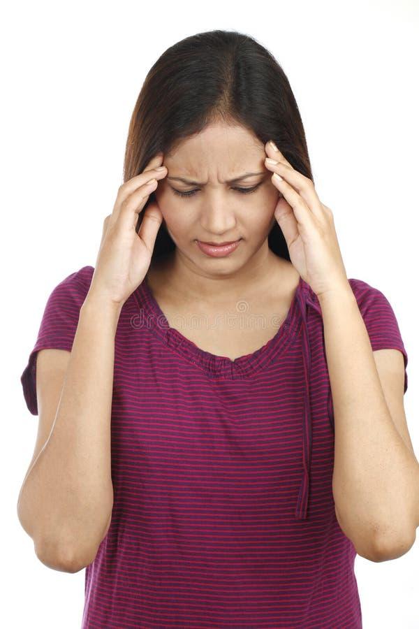Indische tiener met hoofdpijn stock fotografie