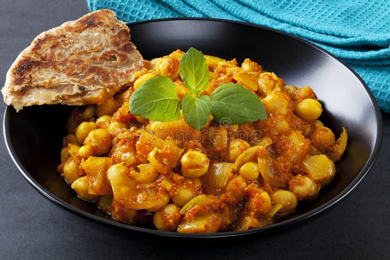 Indische Vegetarische Kerrie Chana Masala stock afbeeldingen