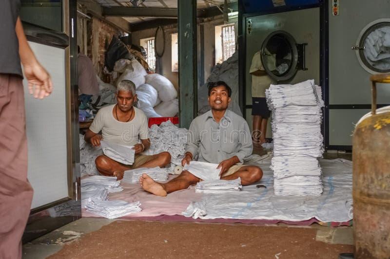 Indische wasserijarbeiders stock foto