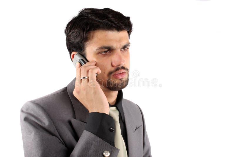 Indischer Geschäftsmann am Telefon lizenzfreie stockfotos