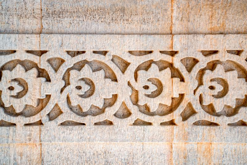 Indisches Wandmuster geschnitzt im Stein lizenzfreies stockbild