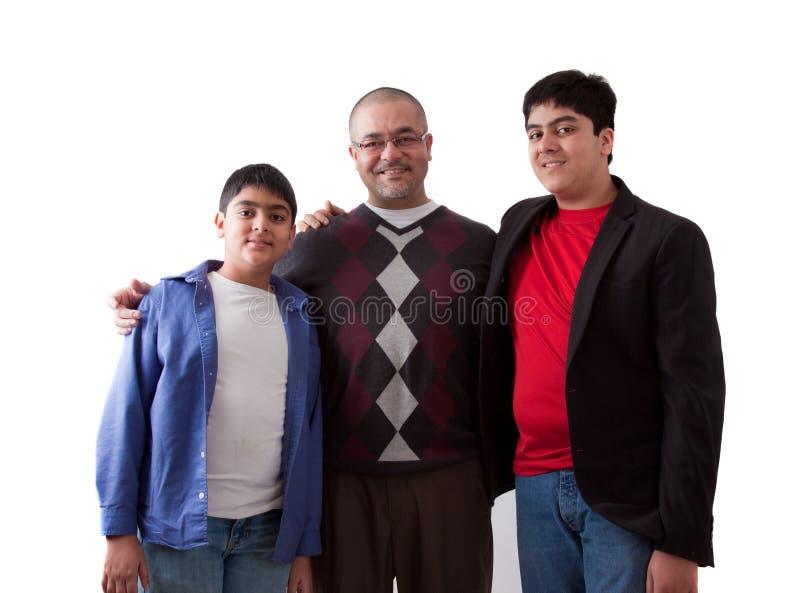 Indisk fader med hans söner royaltyfria foton