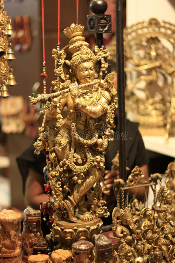 Indisk gudLord Krishna Hemslöjd Guld Förebild royaltyfria foton