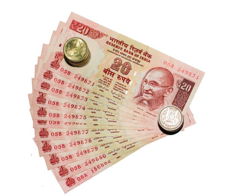 Indisk valutaanmärkning 20 rupier och mynt med vit bakgrund royaltyfri bild