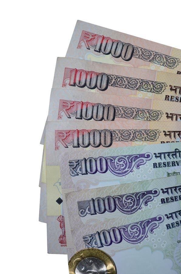 Indiska valutarupieanmärkningar av värde 100, 1000 och mynt arkivfoto
