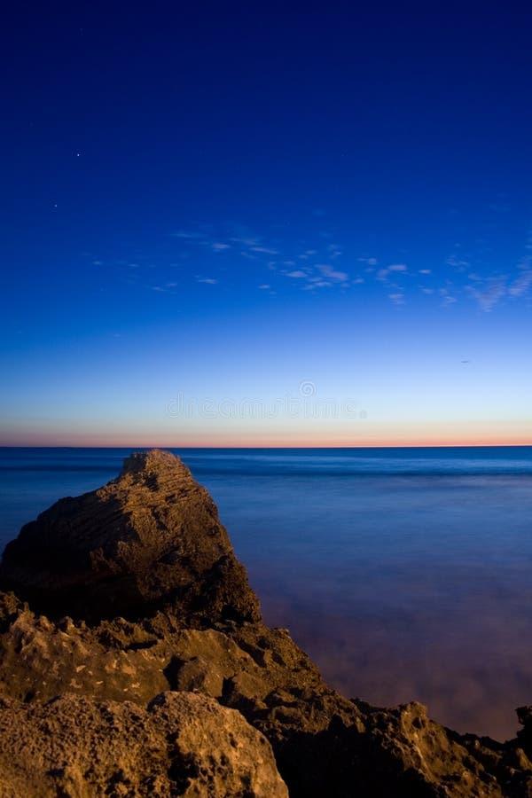 indiskt hav över solnedgång arkivfoto