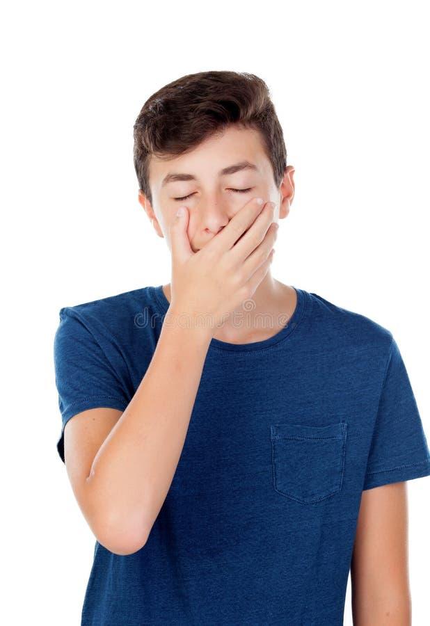 Indivíduo do adolescente que cobre a boca e com os olhos fechados fotografia de stock