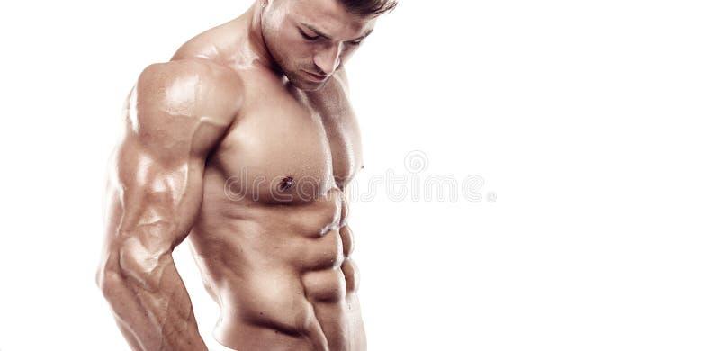 Indivíduo muscular do halterofilista que está sobre o fundo branco imagem de stock royalty free