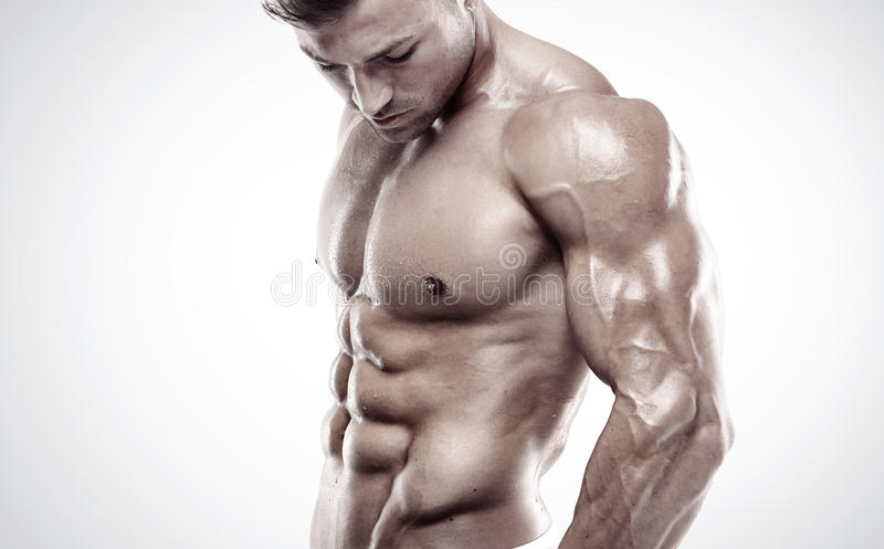 Indivíduo muscular do halterofilista que está sobre o fundo branco fotos de stock royalty free