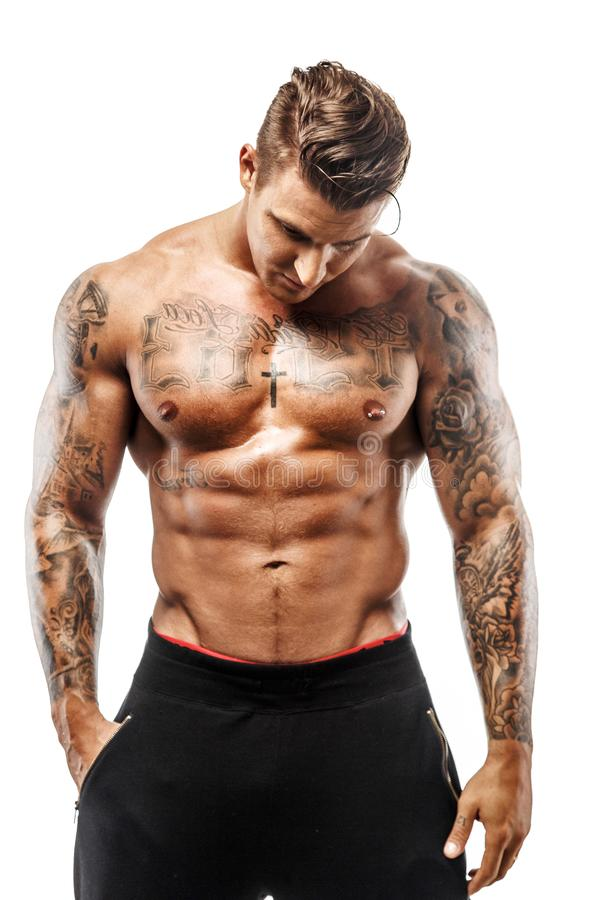 Indivíduo muscular Tattooed foto de stock