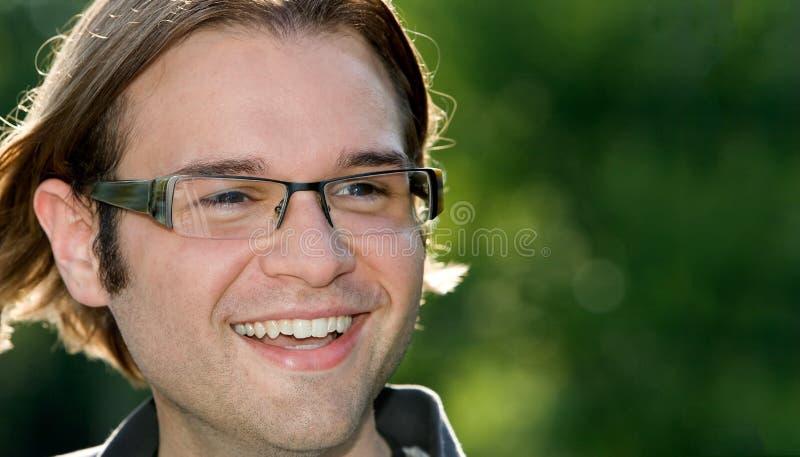 Indivíduo no sorriso dos vidros fotos de stock