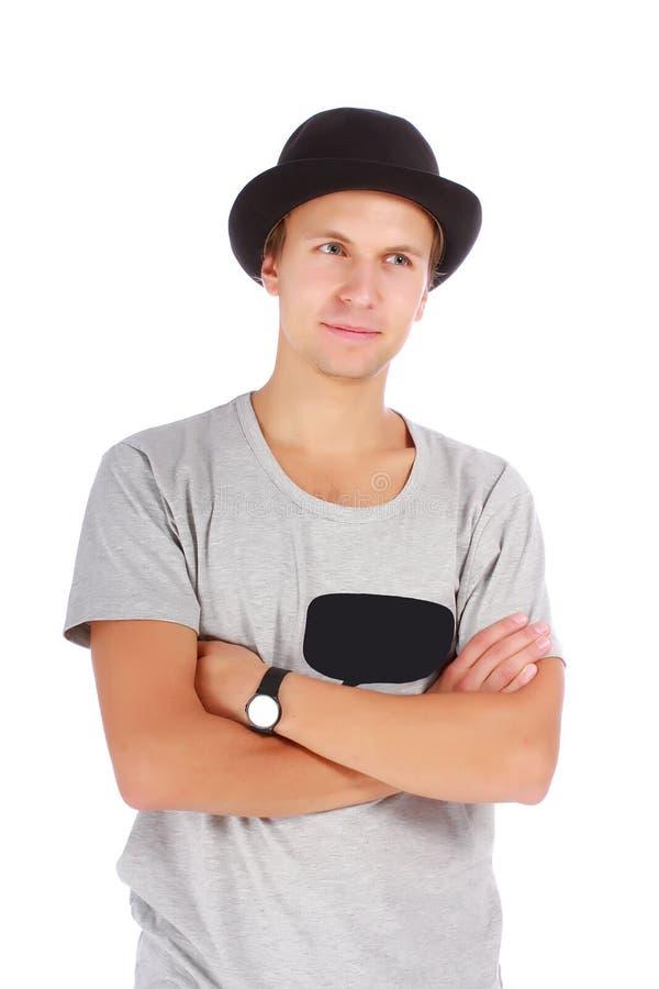Indivíduo novo bonito em um chapéu e em um t-shirt fotos de stock