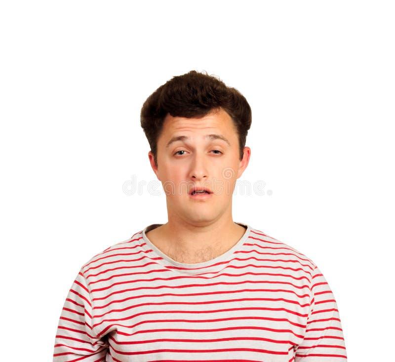 Indivíduo sonolento insatisfeito com cabelo desarrumado e sorriso sombrio homem emocional isolado no fundo branco fotografia de stock