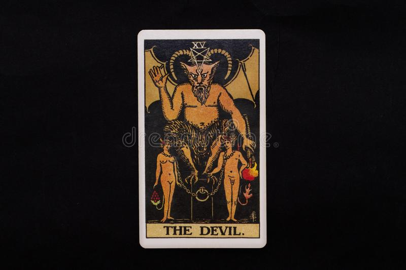 An individual major arcana tarot card isolated on black background. The Devil. royalty free stock image