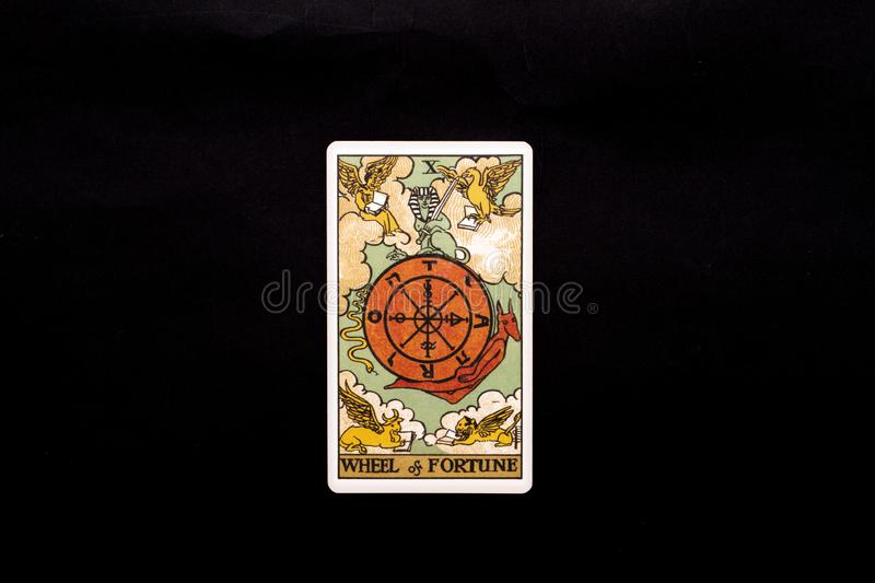 An individual major arcana tarot card isolated on black background. Wheel of fortune. Rider Waite tarot deck. Good to use as a background, or an isolated royalty free stock photo
