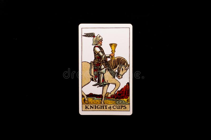An individual minor arcana tarot card isolated on black background. Knight of cups. royalty free stock image