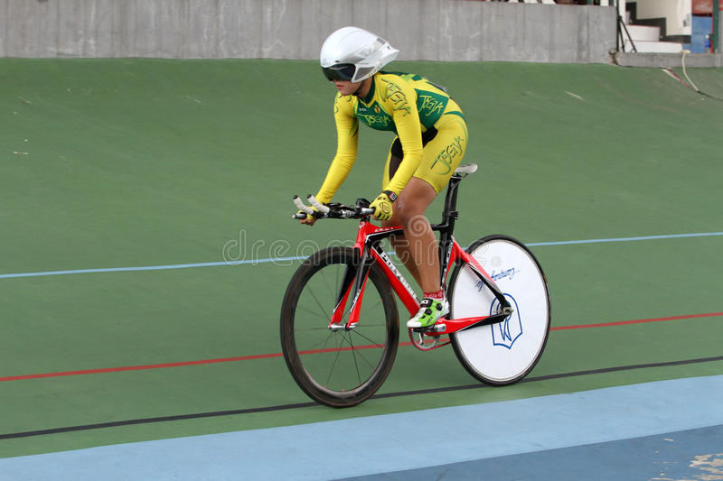 Individual time trial. Cyclists compete in the women's individual time trial on a velodrome in the city of Solo, Central Java, Indonesia stock photos