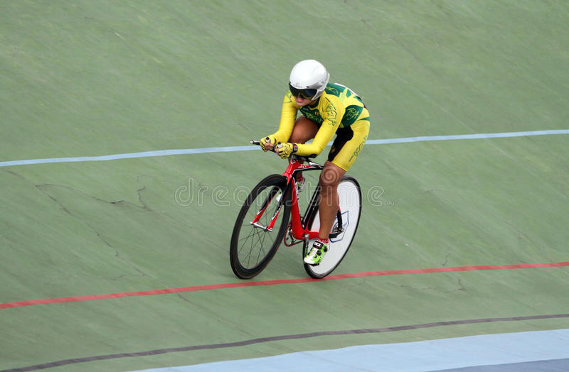 Individual time trial. Cyclists compete in the women's individual time trial on a velodrome in the city of Solo, Central Java, Indonesia royalty free stock photography