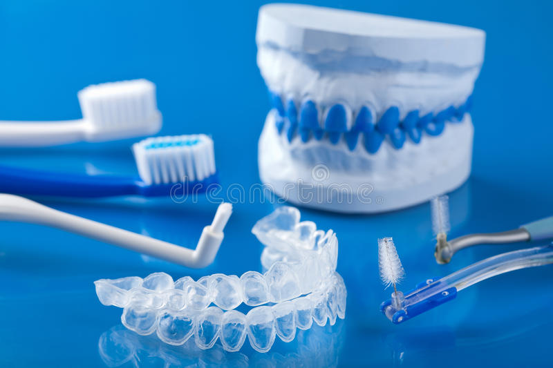 Individual tooth tray for whitening and toothbrushes stock photos