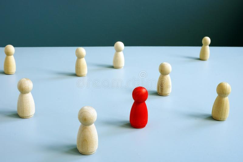 Individuality concept. Different and unique red figurine stock photo
